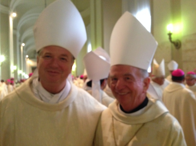 Bishop Bob McGuckin, Bishop of Toowoomba and I before we process out.